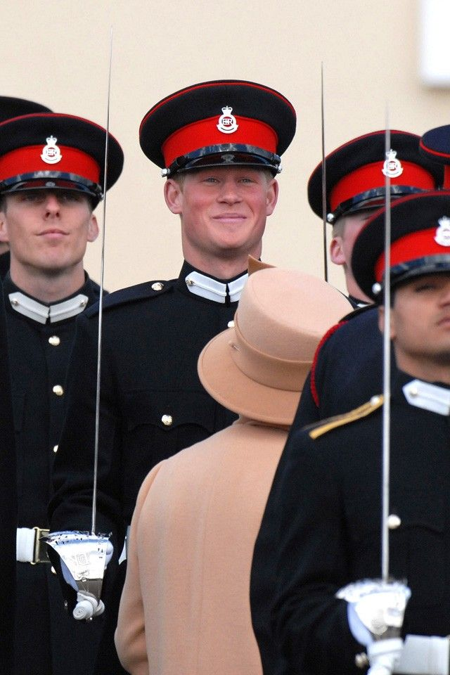 *PRINCE HARRY & QUEEN ELIZABETH II ~ It's April 2006 and Prince Harry's passing out of Sandhurst parade. The lady in the matchy-matchy but completely wonderful coat and hat? That's Queen Elizabeth II, AKA, Granny.