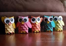 Use the cardboard roll out of paper towel roll.  Glue circles of colours for the feathers, a larger circle for the wings, then paper shape the ears.  Either make your own eyes or use the googly eyes you can buy.