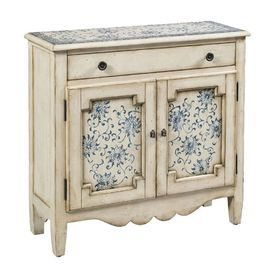"Weathered cabinet with a floral motif.Product: CabinetConstruction Material: Wood composites and hardwood solidsColor: Distressed creamFeatures: One adjustable shelfOne drawer and two doorsDimensions: 35"" H x 36"" W x 12"" D"