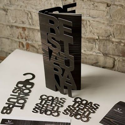 I love the laser cut design in this brochure, it's a different twist on presenting the name.