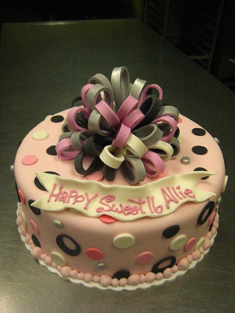 Sweet 16 cake with pink and silver fondant bow
