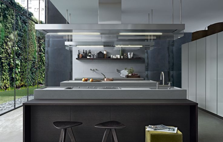 Varenna_Minimal in brown oak, worktop in Serena stone in mat finishing, tall units in quarzo glossy lacquer.