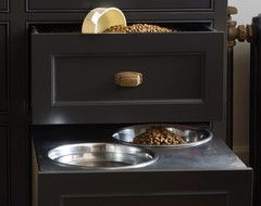 "We went beyond basic decluttering and designed these doggy bowls that are cleverly hidden in drawers. They were designed specifically with the designer's Great Dane ""Tiny Bean"" in mind. Not only are the bowls neatly hidden away when unused, they're also elevated to make eating and drinking easier for a large dog. Add in the food drawer above and you have a great pet friendly and space saving solution!"