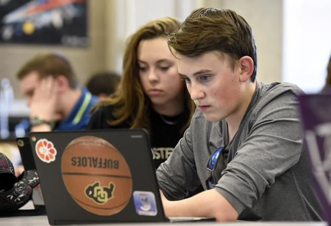 Centaurus High School juniors Taylor Marsh, right, and Tahley Scott take a chemistry test on a Chromebook on Wednesday in Lafayette.