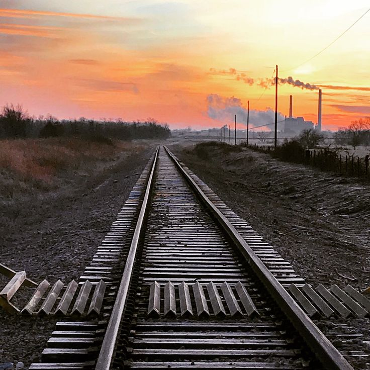 49/365.  Sunrise Sunday.  Train  Tracks.  Taken on 2/18/18 in Pittsburg, Kansas.  #Sunrise #Sunday #RailroadTracks #TrainTracks #Kansas #Pittsburg #beautifulmorning #beautifulsky #February #Winter #Yellow #Red #Orange #Smoke #sun #happiness #joy #love #faith #hopeful #kindness #positivity #behappy #bekind #bepositive #newyearsresolution #photography #freedom