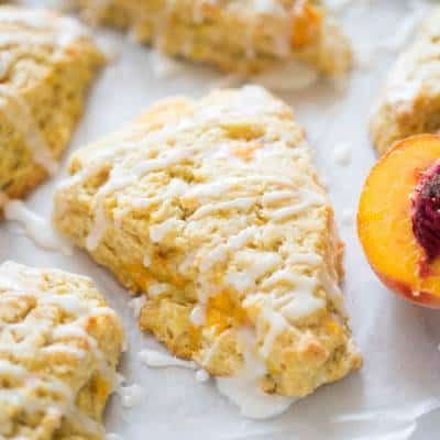Flakey, tender fresh peach scones make the perfect small baked treat for brunch. The perfect recipe to use your fresh peaches this summer.