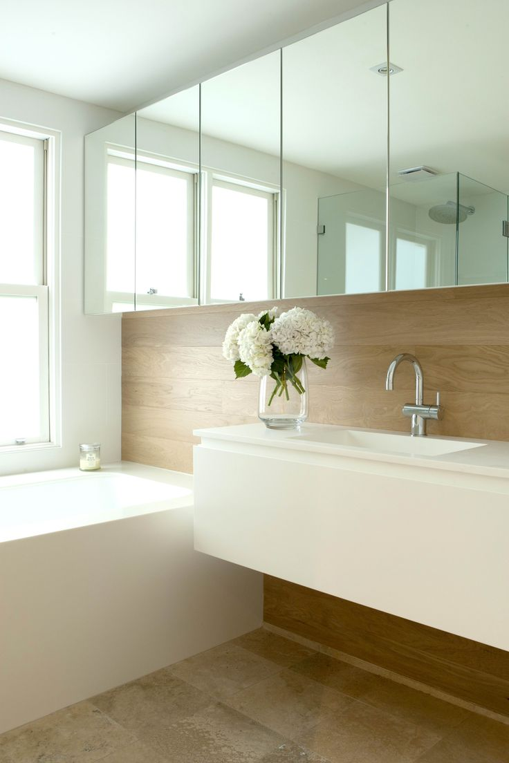 Main Bathroom with Corian clad bath and basin and timber panelling. Brooke Aitken Design.