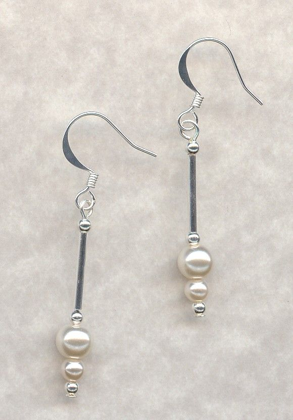 Drop Earrings made with Glass Pearls and silver plated tube beads and round beads. Silver Plated wires.