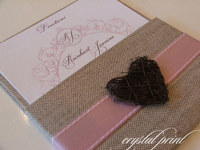 Natural hard covered wrapped pocket wedding invitation.