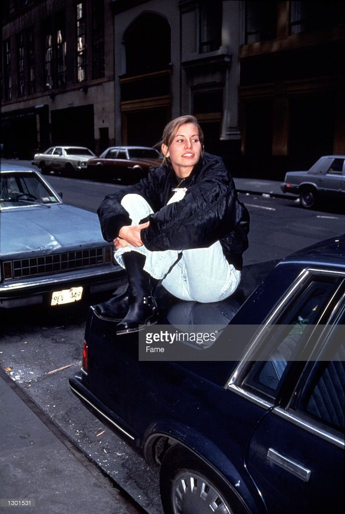 Fashion model Niki Taylor sits on the trunk of a car April 30, 1992 in New York City. Taylor is in critical condition in an Atlanta hospital after suffering severe internal injuries in a car crash April 29, 2001.