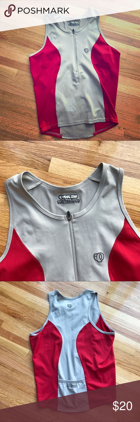 Pearl Izumi biking/running tank top Size medium. Great for biking/running/hiking. Zip up front for easy removal after sweating. Back pocket for goo or any other essentials you might need during your workout. Great condition! Pearl Izumi Tops