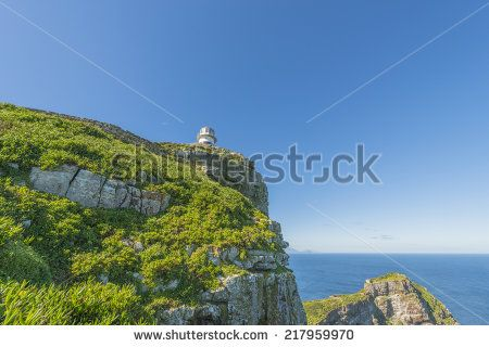 http://www.shutterstock.com/pic-217959970/stock-photo-cape-point-is-located-near-the-city-of-cape-town-south-africa-the-peninsula-has-towering-rock.html?src=l2UmwzKl67EMHu1DgRoo8g-1-30 Cape Point Is Located Near The City Of Cape Town, South Africa. The Peninsula Has Towering Rock Cliffs And Lighthouse That Overlook The Beautiful Ocean View. A Tourism And Travel Hot Spot. Stock Photo 217959970 : Shutterstock