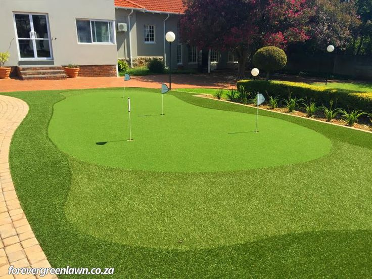 A maintenance free putting green that we created with artificial grass.