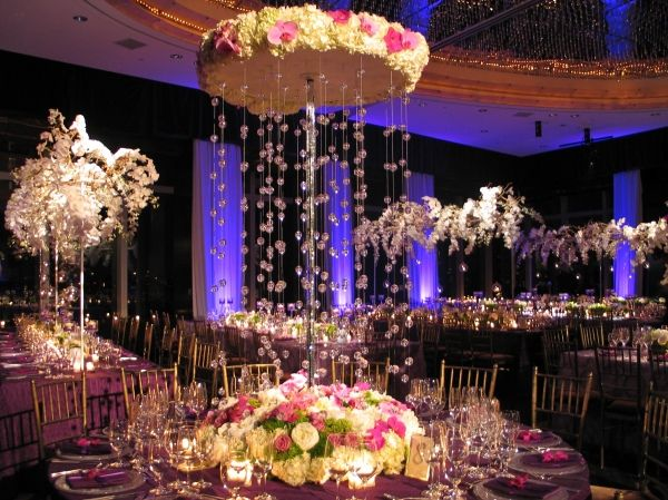 What a unique floral centerpiece with hanging crystals