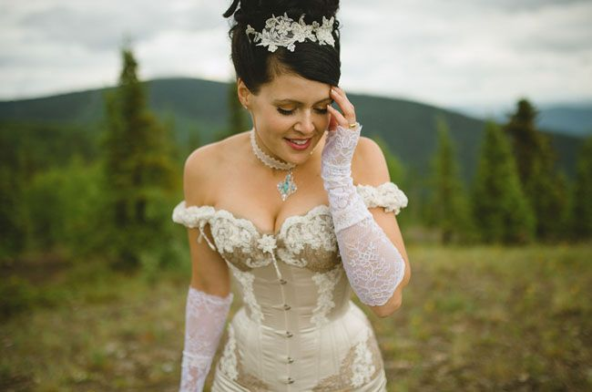Deanna + Aaron's incredible Klondike-themed wedding in historic Dawson City, Yukon (Canada) was so uniquely beautiful and filled with the most amazing Victorian details + attire. Guests attended the ceremony in full period costume and Deanna wore a gorgeous custom-made couture corset gown