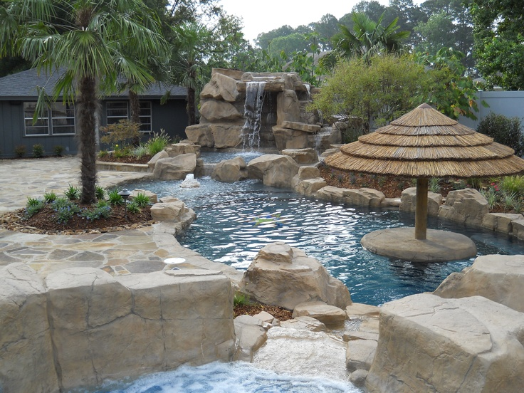 Looking from the spa, this gunite saltwater pool with Rico ...
