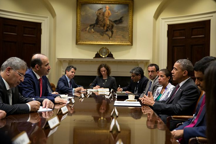 President Barack Obama drops by National Security Advisor Susan E. Rice's meeting with Syrian Opposition Coalition President Ahmad Jarba, second from left, in the Roosevelt Room of the White House, May 13, 2014.