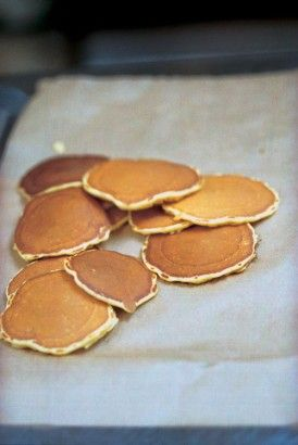 When I was a child, we often had Scotch pancakes (out of a packet) when we got home from school. And the thing - for those of you who don't know - about Scotch pancakes is that they are not eaten like pancakes - hot with syrup and a knife and fork - but like toast, spread with butter and jam. I always remember them being on the cold side of lukewarm, but I think warm, though not so hot as to burn your fingers, is what you're aiming for.