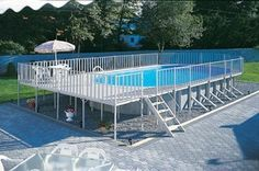 Above-Ground Swimming Pool Designs, Shapes and Styles: An oval-within-a-rectangle Doughboy pool.