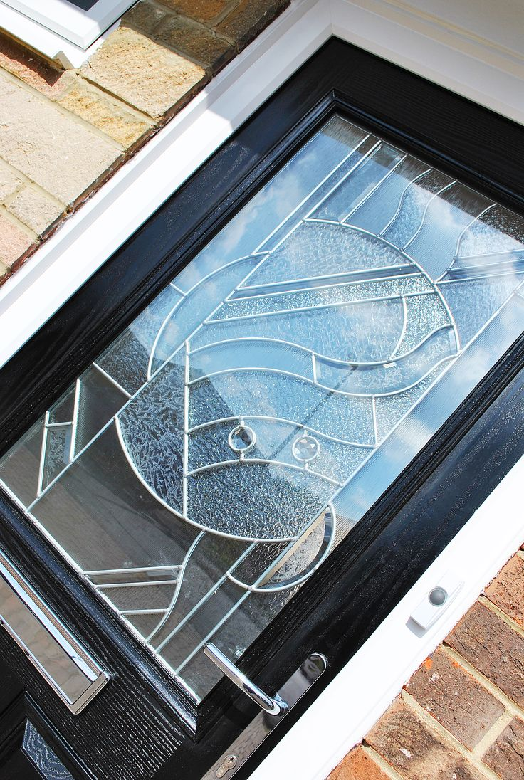 Stunning black parama composite door with zinc art for Art glass windows and doors