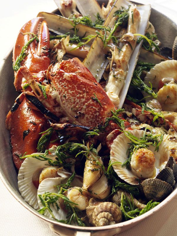 A platter of mixed shellfish is a great indulgent dish to order in a restaurant or serve for a dinner party. You can really use any kind of shellfish, but try to limit the selection to about four varieties, or you will have too many different cooking times to contend with.