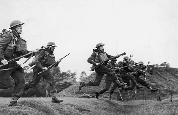 Czechoslovak infantry troops take part in a bayonet charge whilst training in Britain during World War II circa 1940