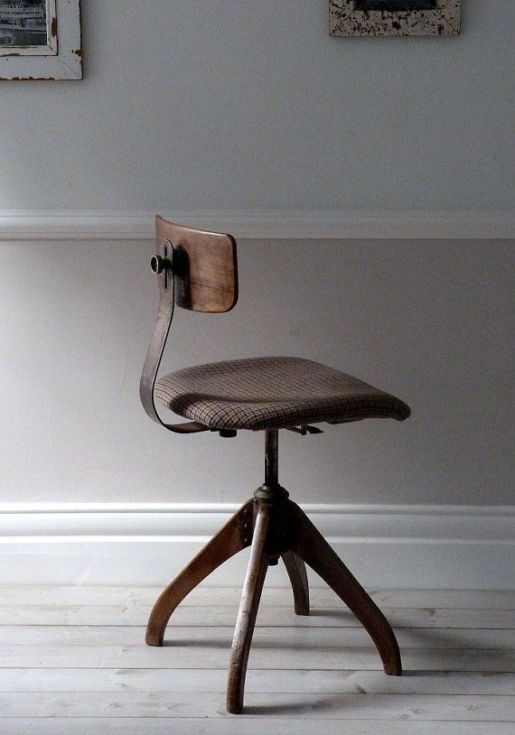 An incredibly stylish and comfortable architects / desk chair.    It has a lovely aged patina and is fully adjustable. The seat is covered in a