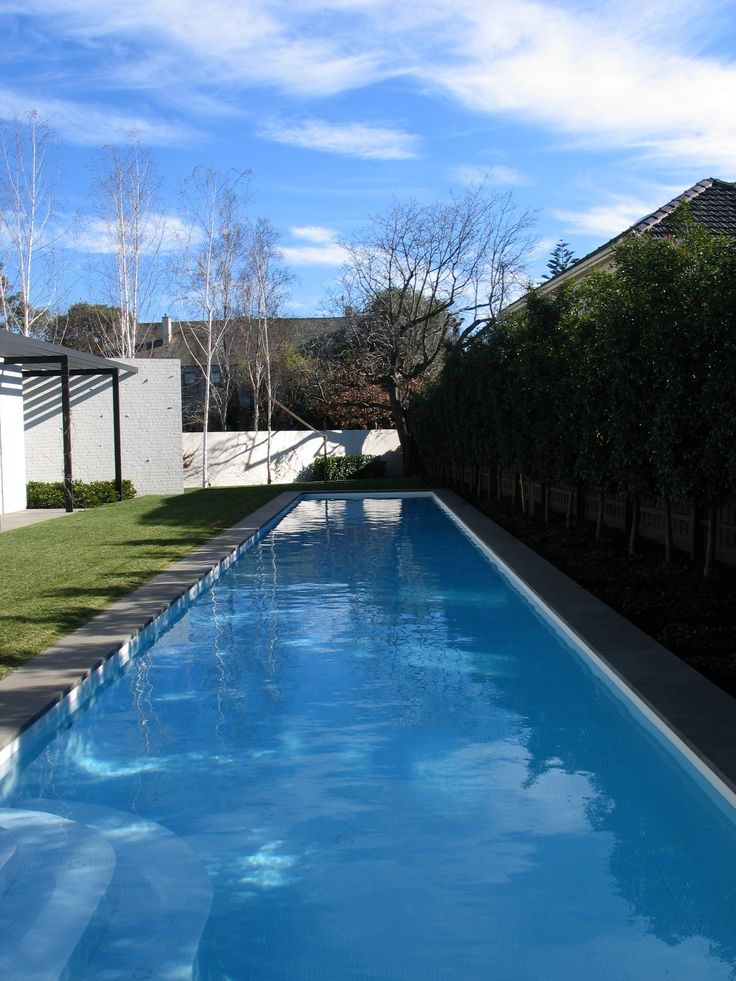 20m lap pool with white bisazza glass mosaic tiles and bluestone coping. designed by allan powell architects.