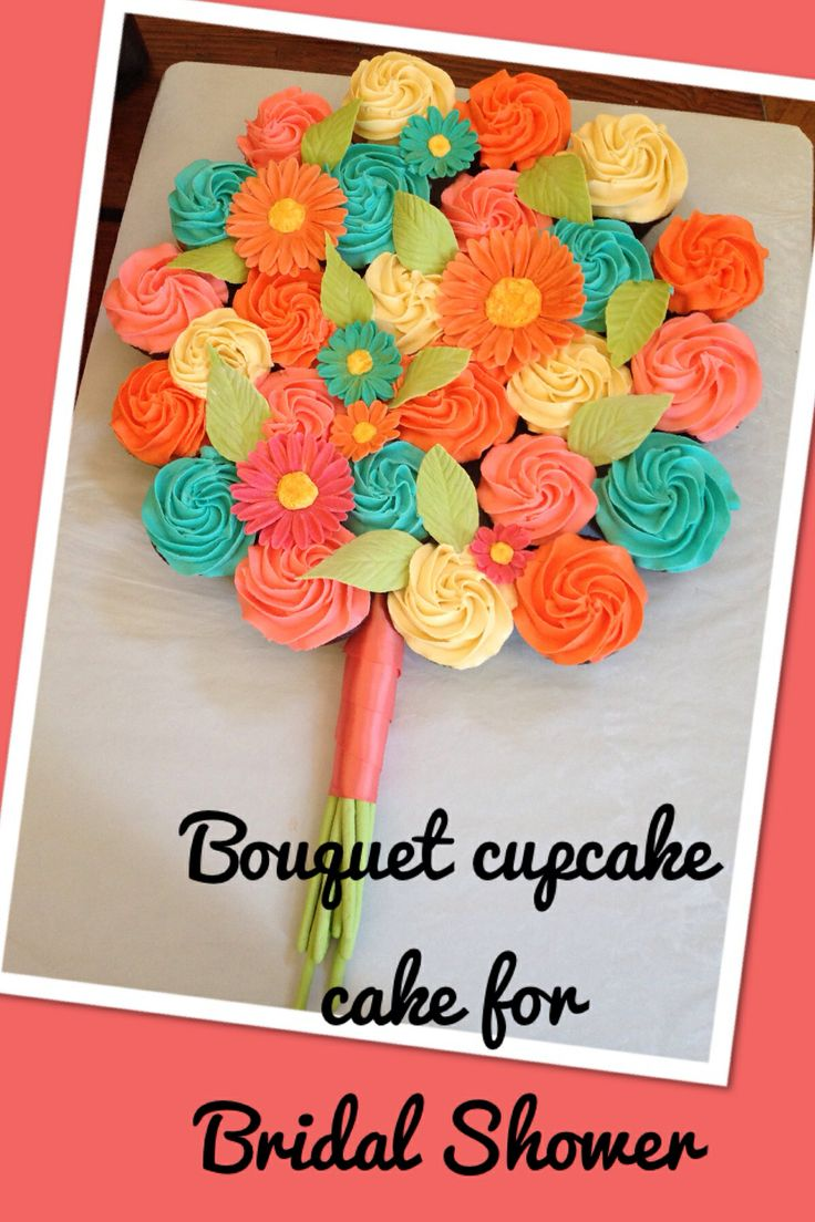 Bouquet cupcake cake for bridal shower. Tropical colors. Flowers and leaves are fondant, stems are gumpaste and wrapped in ribbon.