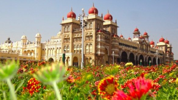 """Mysore city, also known as """"City of Palaces"""" is located at the base of the Chamundi Hills in Karnataka. You can take a bike and enjoy the well maintained National Highways from Bangalore stretching towards Mysore. Along with the palaces, you can also stopover Mysore Zoo, Museum and Brindavan Garden.  credits:http://www.mouthshut.com/"""
