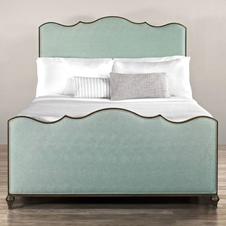 Wesley Allen's Evans Iron & Upholstered Bed by Humble Abode offers dozens of fabric and leather choices, made in the USA. It's a premium quality iron bed frame with subtle curves.