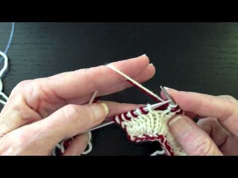 This video shows double knitting with both colors held in left hand. It also shows two types of edge stitches and how to change colors for two color patterns.
