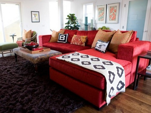 love the shag carpet and this beautiful red sofa!