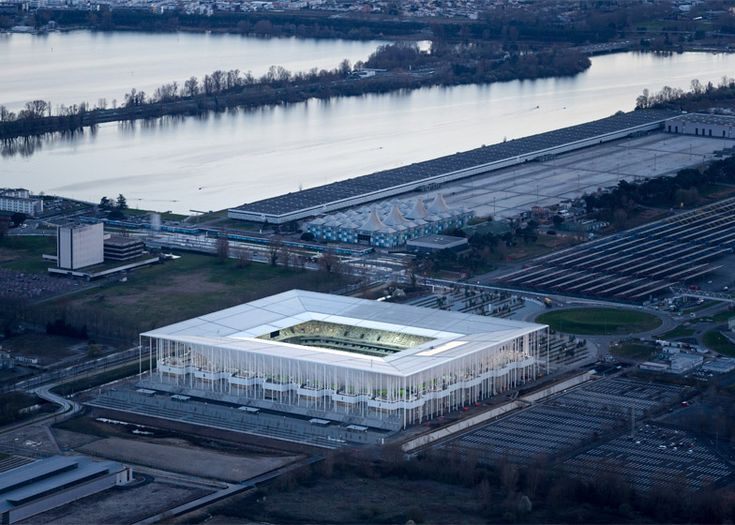 Herzog & de Meuron's Bordeaux Stadium is framed by a forest of slender…