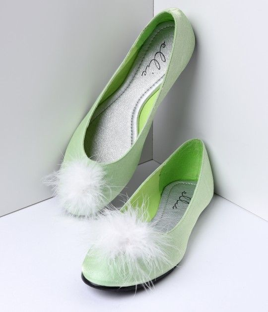 Just a dash of pixie dust please! These Mila vintage shoes are a precious pair of retro style flats in a sparkling light green sheen with soft white feather pom pom on the toe. Get ready to fly, darling! <br /><br />Please note all shoes have a 4 day hand