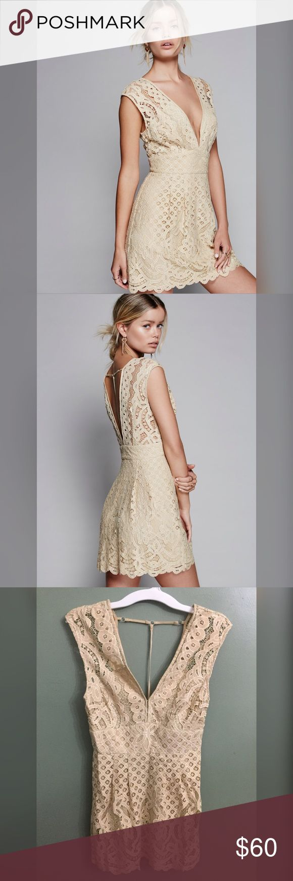 """NWT Free People """"One Million Lovers Lace"""" Dress, 6 Lovely lacey dress featuring a front and back plunging V with a cute back strappy detail. Femme fit-and-flare shape. Hidden side zipper closure. Lined. Measures approximately: Size: 6  Bust: 32 inches  Waist: 28 inches  Length: 32 inches from shoulder seam  60% Cotton 40% Nylon Color: Ivory. Hand Wash Cold Free People Dresses Mini"""