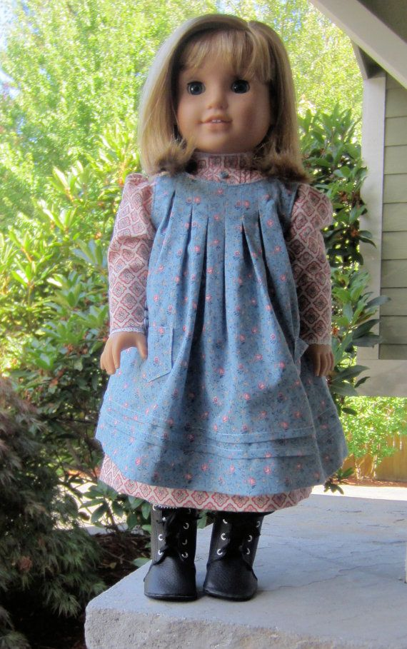 Ann Van Doren Designs introduces a pattern for an 18 doll dress and apron as worn by a young American girl in the early 1900s. The dress flows into an A-line from small tucks at the neckline, ending with a growth tuck near the hem. Leg of Mutton style sleeves close with tiny buttons and loops at the wrist. The apron features box pleats at the neckline with two smaller growth tucks near the hem and optional patch pockets. This revised version includes pattern pieces for a plain apron back…