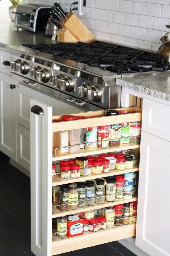 white kitchen stainless steel range spice cupboard
