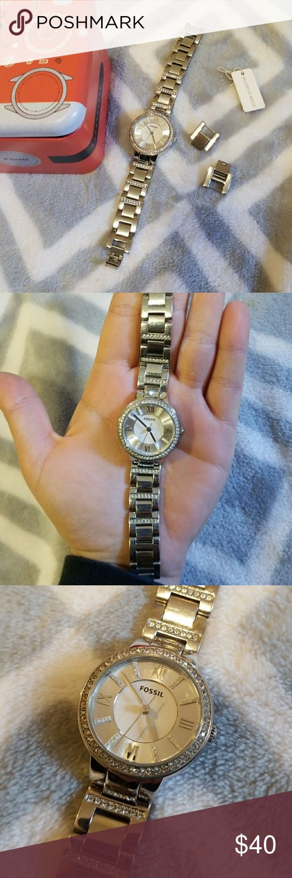 ▪FOSSIL▪ Watch Gorgeous silver watch with Roman numerals and crystals on the face.  Crystals also surround the face and line some of the links.  Comes with two extra links. It does need the battery replace by a professional.  Some slight scratching on links as seen in photos. Fossil Accessories Watches