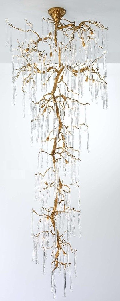 Glamour staircase chandelier by Serip made up of handcrafted bronze and handblown glass. uploaded by user-- no source.
