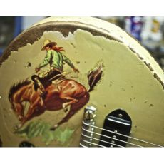 Cowboy on bucking bronco horse is the theme of this vintage guitar by Jimmy Carbonetti. RESEARCH  #DdO:) - https://www.pinterest.com/DianaDeeOsborne/instruments-for-joy/ - INSTRUMENTS FOR JOY.  This guitar designer using old & vintage guitars also began as student of Giorgio Gomelsky, who as a promoter and manager  was instrumental in launching the careers of both the Rolling Stones and the Yardbirds. LaBella is one of the dealerships listed as selling this luthier's creations. A UNiQUE pin.