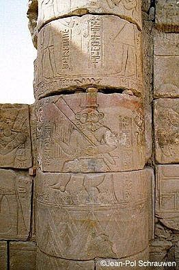 The god Bes dancing and playing the harp.  Carving on the pillar at the Hathor Temple at Philea, Biga Island, Aswan. Ptolemeic Dynasty, 332-30 BC, Greek Macedonian Rule.