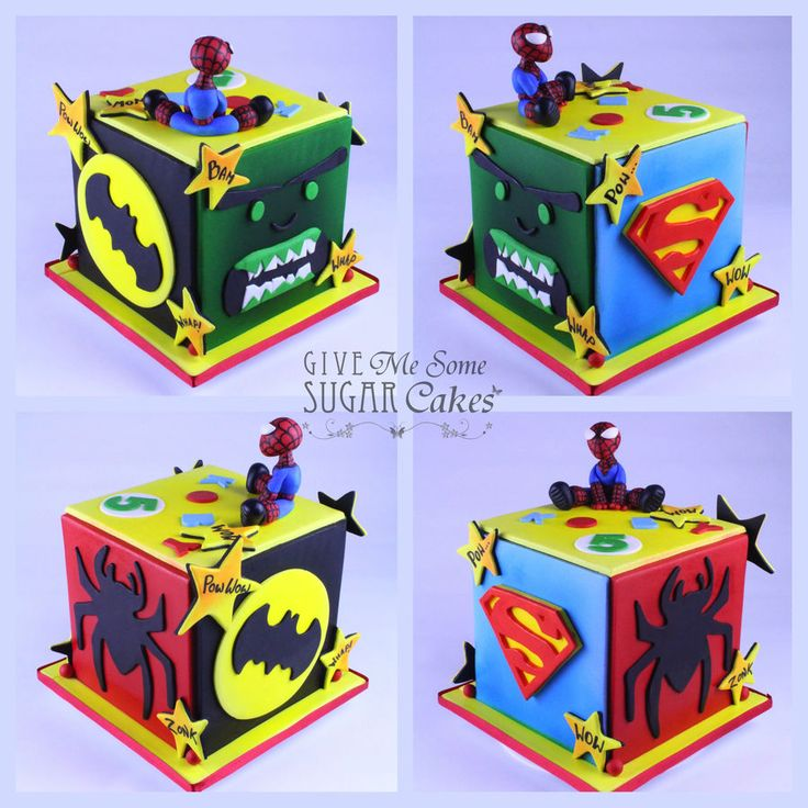 Superhero cake ~ Cube cake, each side has been decorated with a different superhero. On top is a fondant spideyman