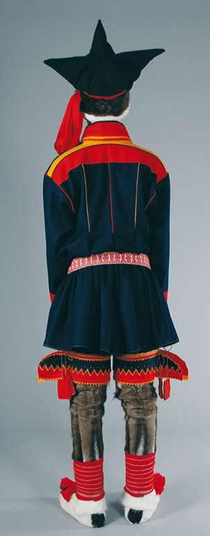Sami costume: a northern Sami man wearing the pointed cap and reindeer leggings with wings..