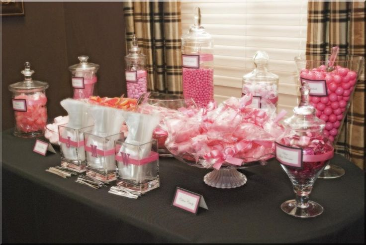 Pink and coral buffet. Love the idea of the small square glass vases holding the cello bags.. brilliant.