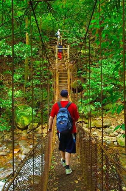 Hiking across a rickety old bridge in Rincon de la Vieja NP, Costa Rica