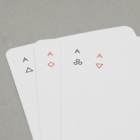 IOTA by New York-based designer Joe Doucet, is a deck of playing cards printed with simplified geometric symbols and minimal lines.
