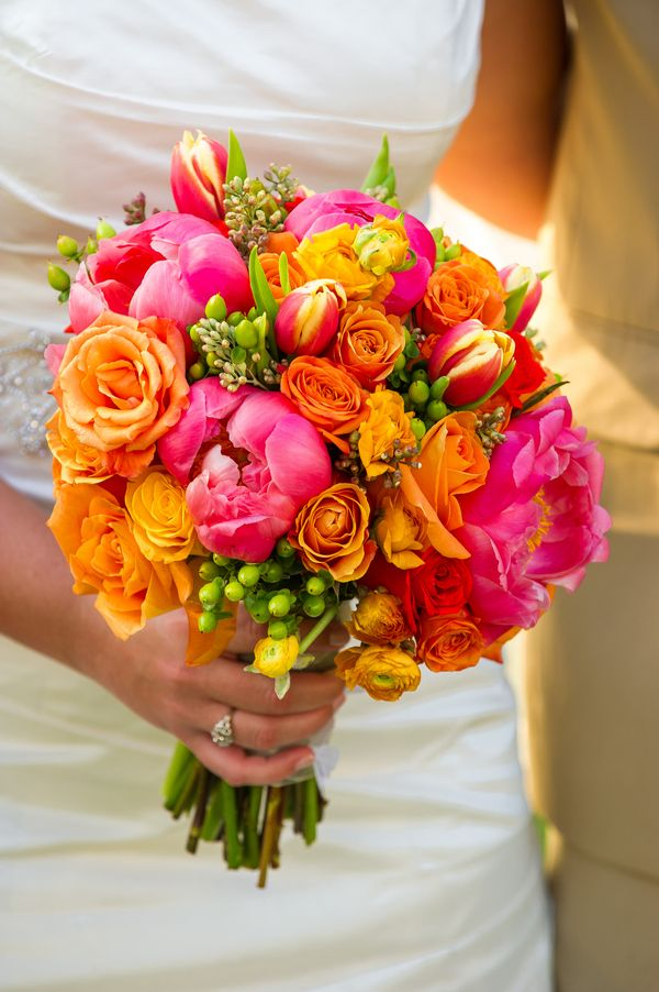 Love this bright wedding bouquet, except the green things. Those could be replaced with lime green flowers!:)