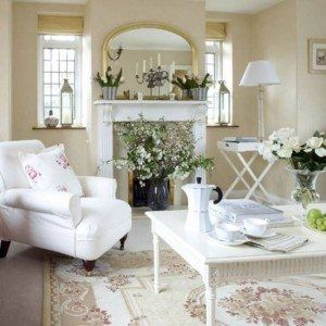 Country Style Living Rooms With Neutral Color Scheme And White Furniture And Mirror Over Mantel And Flower Vases And Area Rug , Best Country Style Living Rooms In Living Room Category