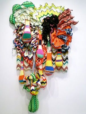 Miyoshi Barosh is a graduate of both the Rhode Island School of Design, and the California Institute of the Arts. Her soft sculpture is an accumulation of many layers, colors and textures. Miyoshi blends embroidery, crochet and knitting using recycled sweaters and blankets as raw materials for her dimensional, cozy sculptures.